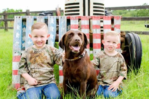 2 young boys and their trusted dog